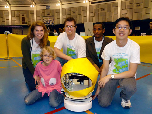"Pictured from left to right are Saint Mary's College student Theresa Nucciarone and University of Notre Dame students Travis Brown, Sam Njoroge and Kai Zhao. In front as the ""ghost"" is Ellie Brown, daughter of Travis, and ""Pac-bot."""