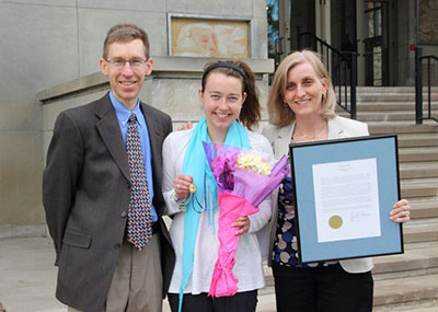 Sarah Lipinski '15, the 2014 recipient of the Saint Catherine Medal, poses with her parents outside O'Laughlin Auditorium following Honors Convocation. Not only was Sarah surprised by the recognition, she was surprised that her parents were there.