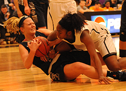 Eleni Shea dives after a loose ball in the second half at Kalamazoo.