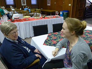 Sister Charles Allen Reynolds, CSC, enjoys hearing Saint Mary's College student Maddie Cushing, right, recount highlights of the time the two spent together as part of an oral history project focused on faith-sharing.