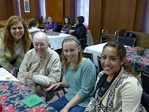 Saint Mary's College students and Sister Jane Frances Reus, CSC, are all smiles as they celebrate the completion of an oral history class project that evolved into eye-opening experiences of faith-sharing and friendship for both students and Sisters of th