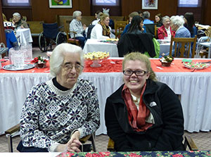 Saint Mary's College student Jackie Rooney '17, right, and Sister Susan Kintzele, CSC, enjoy refreshments and each other's company during a reception celebrating the completion of the oral history class project.