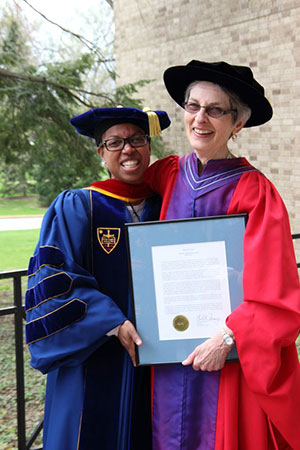 Professor Phyllis Kaminski, right, poses with Stacy Davis, associate professor of religious studies, who was among those who nominated her for the Maria Pieta Award.