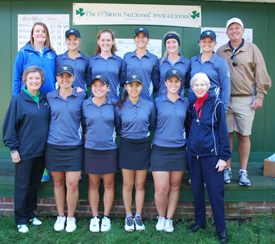 The golf team poses with the O'Brien family and Athletic Department chaplain Sister Lou.
