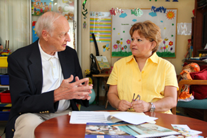 Maria Casadio, of South Bend, right, sits down with Jack Ruhe, professor emeritus of business at Saint Mary's College, to go over her business plan for a bilingual daycare. Casadio participated in SPARK in 2011 and still receives help from SPARK.