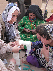 Zeba fashions a sling out of a piece of wood. Limited medical equipment is one of the harsh realities for FET members who tend to the sick and injured.