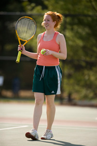 Saint Mary's female student playing tennis