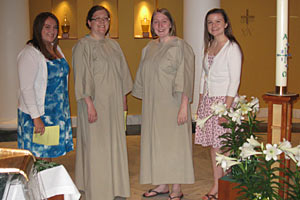 Angela, third from left, was baptized into the Cathlic faith last year along with Randi Beem '11, second from right. Also shown are their sponsors Erin Valencia '11, far left, and Christine Hendershot '12, far right.