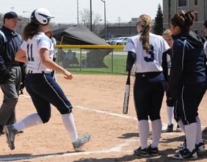 Jillian Busfield scores on her first of two home runs in the game one win.