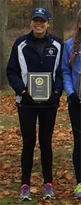 Brittany Beeler with her All-MIAA First Team plaque.