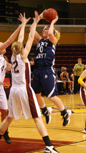 Jessica Centa goes up against two Calvin defenders in the MIAA Semifinal game on Thursday.