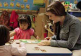 Meghan MacKinnon works with young children at ECDC