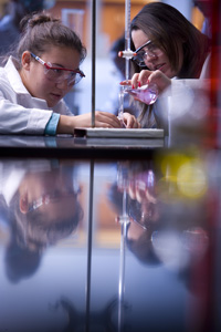 students doing a chemistry experiment