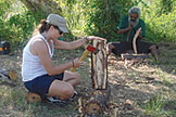 Chevonn Fant chopping wood in aboriginal village