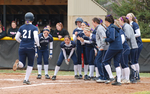 Chrissy Porter (21) comes in to score on her home run in the Belles' 1-0 win.