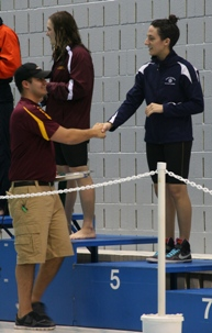 Audrey Dalrymple is congratulated on her fifth place finish in the 200 IM. (Photo courtesy Jeff Febus, Calvin College)
