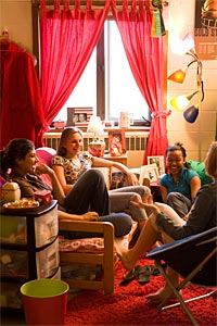 students laughing in a dorm room