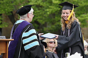 Nursing student Teresa Dudding '11 receives her diploma from Saint Mary's President Carol Ann Mooney at Commencement, May 21, 2011.