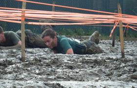 Katie Griffin participates in a Mud Run with fellow NROTC - Marine Officers.