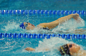 Griffin edges an opponent earlier this year in the 100 backstroke.