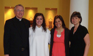 Father John Pearson, CSC; Emily Treat; Hayley Bojorquez; Judy Fean all pose at the Church of Loretto