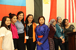 Participants of an international women's leadership program at Saint Mary's gather in front of the flags of their countries. Funded by a grant from the U.S. Department of State, the program hosted students from five countries.