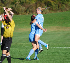 Katelyn Tondo-Steele and Maddie Meckes celebrate the Belles' first goal on Tuesday.