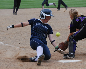 Kristen Nelson slides in ahead of the throw and scores a run in game two at Albion.
