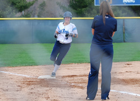 Monica Palicki rounds third base after hitting her first career home run.