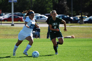 Ashley, left, plays forward for the Saint Mary's Belles soccer team.