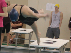 Carolyn Neville jumps off the block in the 50 free on Thursday night. (Photo courtesy of Bobby Lee, Albion SID)