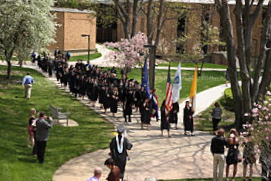 A procession of honors graduates and faculty heads to O'Laughlin Auditorium for Honors Convocation.