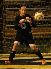 Chanler Rosenbaum makes one of her eight saves against Adrian on Thursday night.