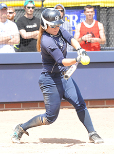 Kayla Chapman connects with her  go-ahead grand slam against Trine.