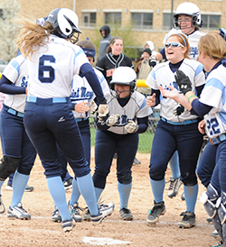 Cassie Young (#6) leaps home on her walk-off grand slam in game one.