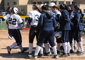 Callie Selner touches home after hitting a walk off two-run home run in game one.