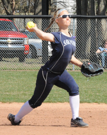 Emily Sherwood throws out a runner at first.
