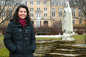 Silvia, a business administration major, visits one of the college's most beloved spots: a statue of Saint Mary on an island in Lake Marian.