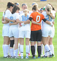 Saint Mary's soccer team in huddle and earned the fourth place in the 2014 MIAA Women's Soccer Preseason Poll