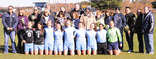The nine seniors on the soccer team were recognized prior to the start of the game.