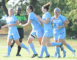 Emily Rompola (second from left) celebrates her second goal.