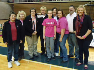 Representatives from Young Survivors receive a check from representatives from Stanley Clark School at the Belles' Think Pink Game.