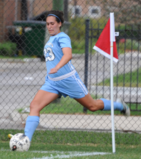 Kaitlin takes a corner kick this past season.