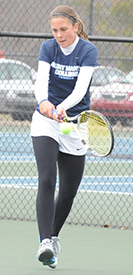 Andrea Fetters connects on a backhand return in her one singles match.