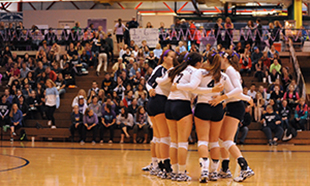The Belles huddle up at their Domestic Violence Awareness match against Alma.