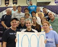 Kati Schneider celebrates her 1,000th kill with her family on Friday.