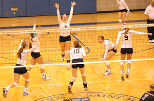 The Belles celebrate after winning match point against Kalamazoo.