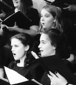 women's choir singing