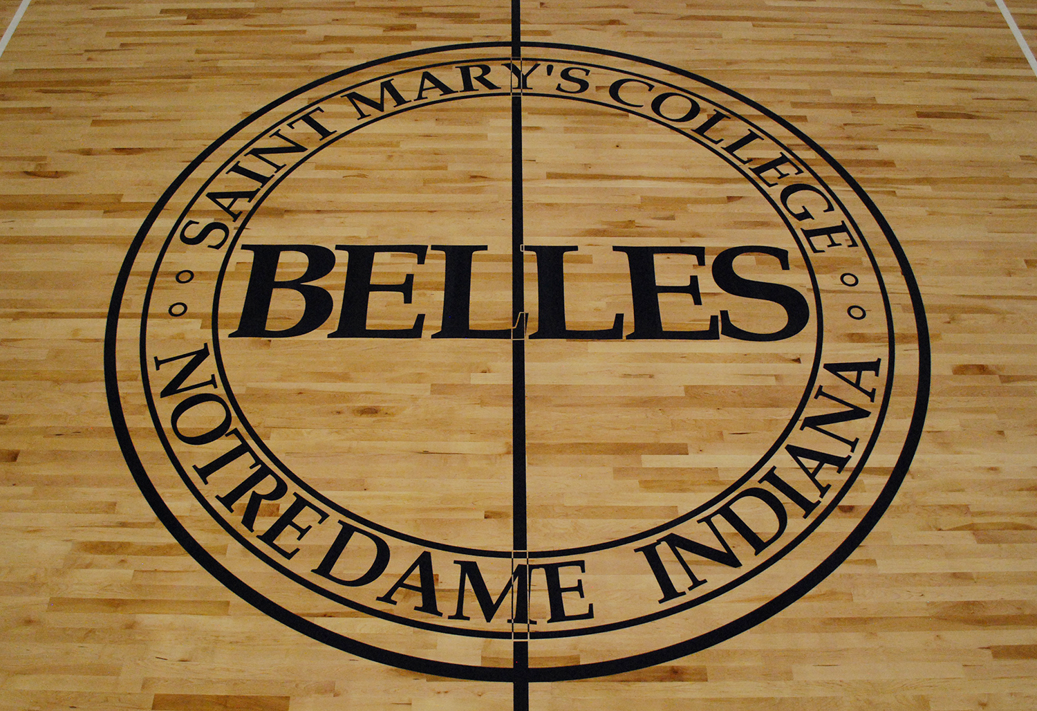 Basketball performance court floor with Saint Mary