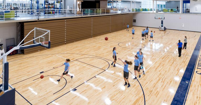 Students playing basketball at Angela Athletic & Wellness Complex
